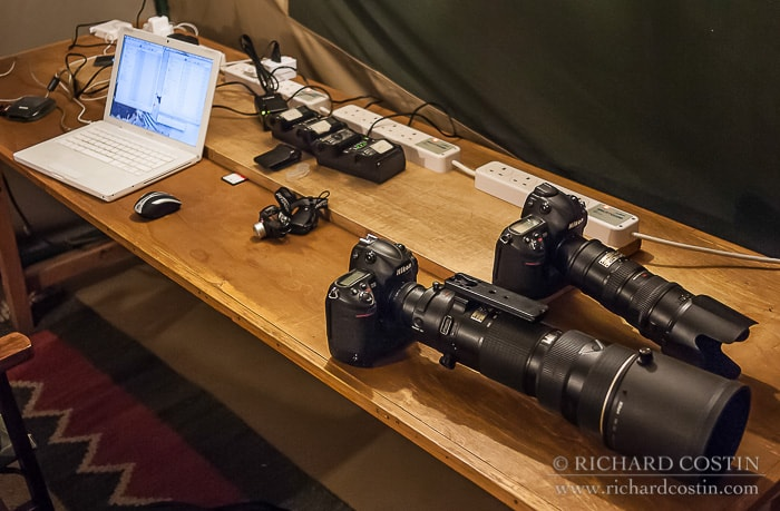 African Wildlife Photography Workshop in the Masai Mara Nikon Gear on charging desk