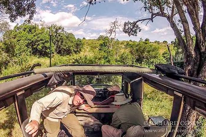 wildlife photographer Richard Costin preparing his safari 4x4 toyota land cruiser for a day of photography