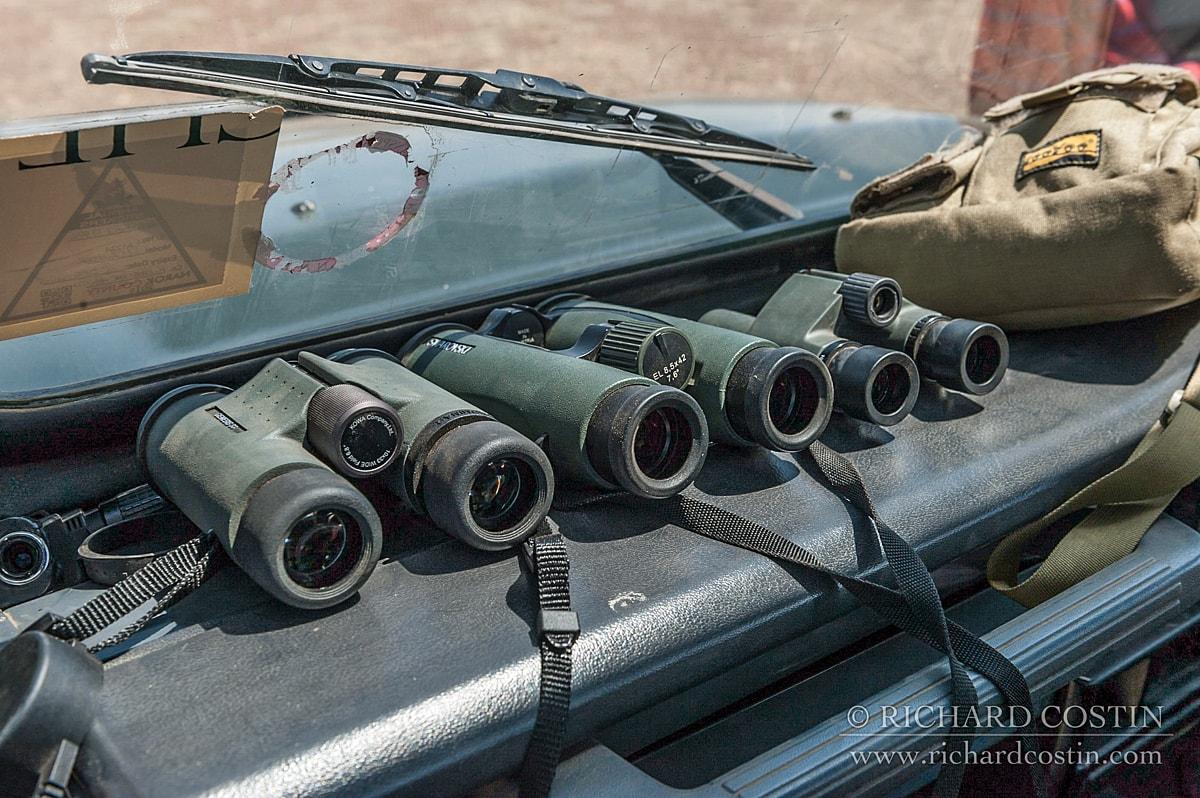 kowa and swarovski binoculars on the land cruiser dashboard on safari